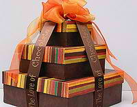 Personalized boxes tied with imprinted ribbon from Initial It Please