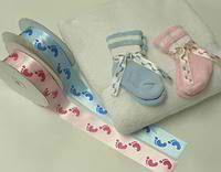 Personalized ribbon and baby booties available from Initaial It Please